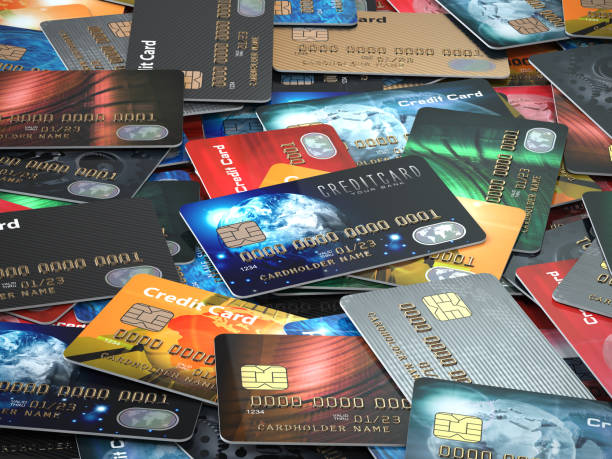 Pile of colored credit cards background, stock photo
