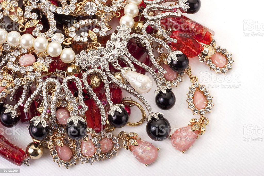 Pile of colored jewellery on white background royalty-free stock photo