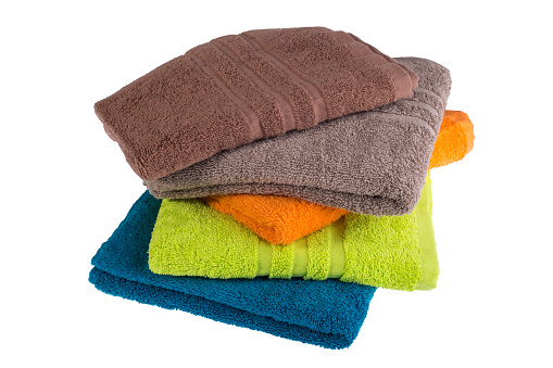 1131900491 istock photo Pile of colored towels isolated on white background 658501676