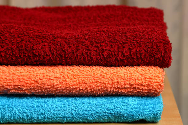 Pile of colored towels. stock photo