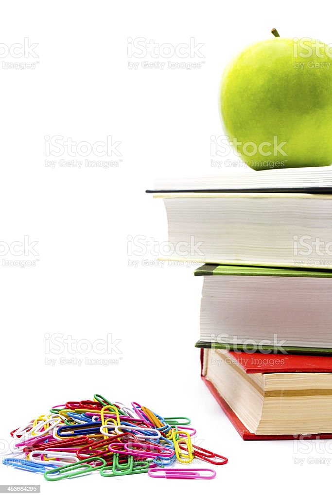 Pile of colorful books and apple on white background. royalty-free stock photo