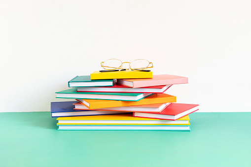 Pile of colorful books and notebooks. Education, study, learning, teaching concept
