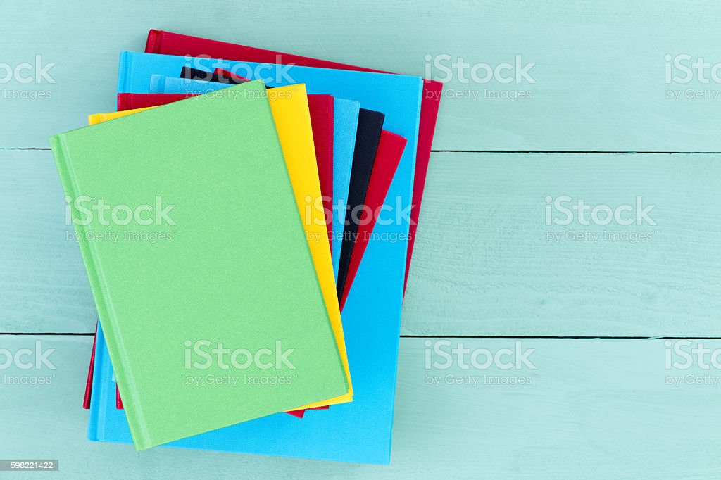 Pile of colorful hardcover books stock photo
