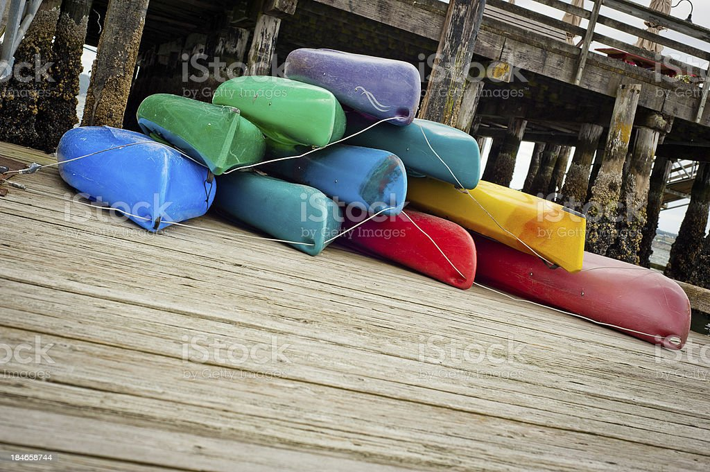 Pile of Colorful Kayaks royalty-free stock photo