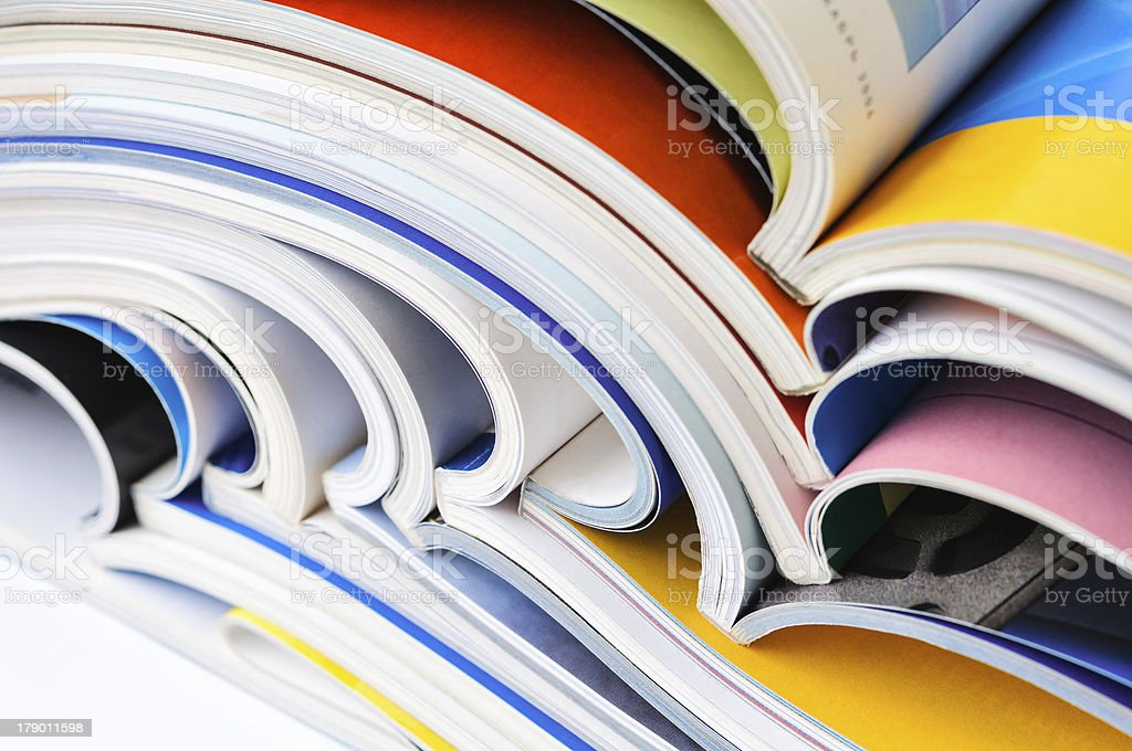 Pile of colorful magazines stock photo