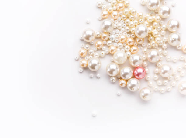 Pile of colorful pearl on white background stock photo