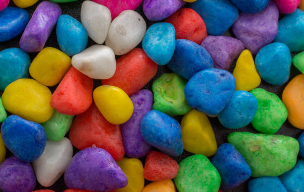 pile of colorful pebbles as a stone background - granite rock stock photos and pictures