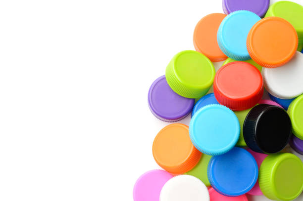 pile of colorful plastic bottle cap on white background - plastic cap stock pictures, royalty-free photos & images