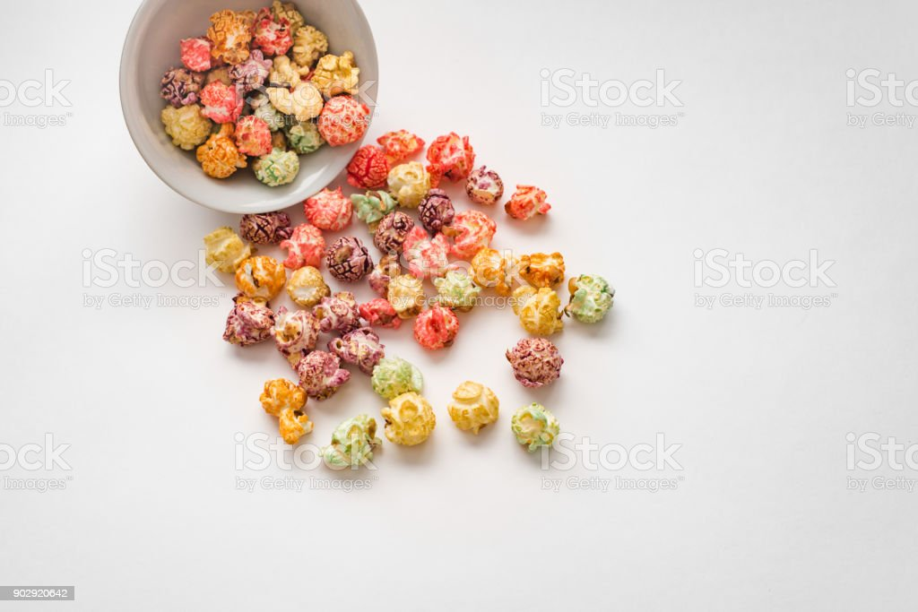 A pile of colorful popcorn, still life for a holiday with colorful popcorn isolated on white stock photo