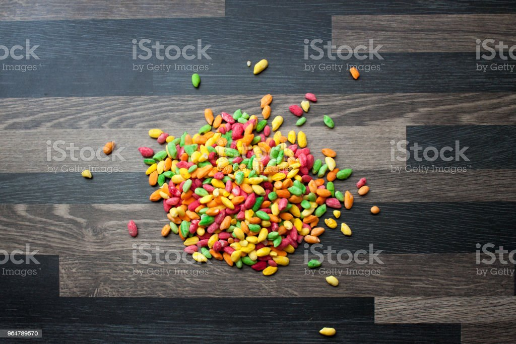 A pile of colorful rice on a gray kitchen counter top royalty-free stock photo