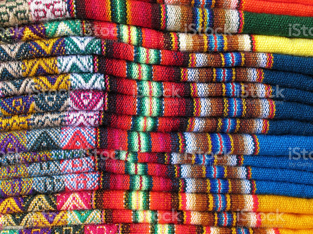 A pile of colorful South America Indian woven fabrics stock photo
