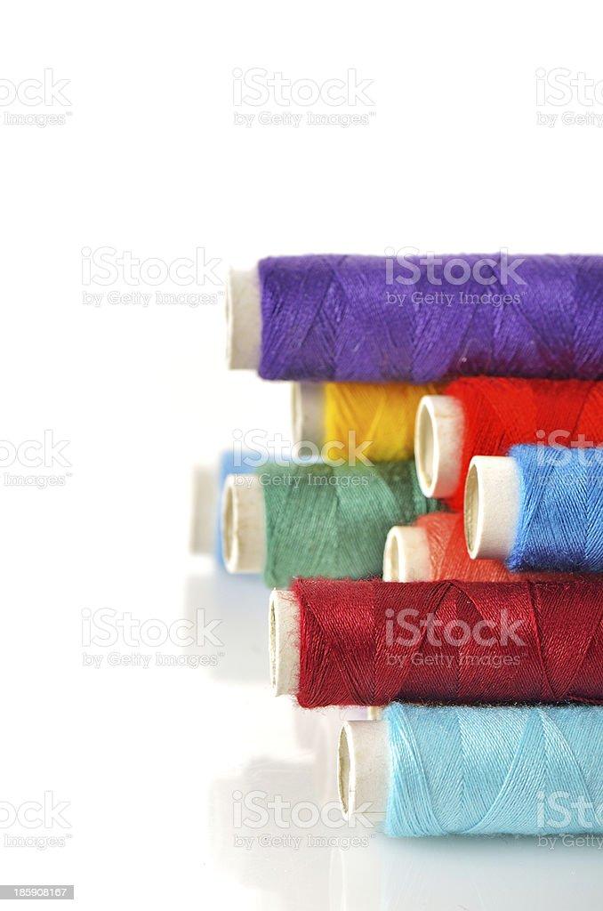 Pile of coloured bobbins royalty-free stock photo