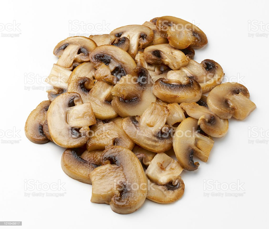 pile of cooked mushrooms stock photo