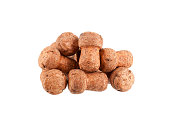 Pile of corks from champagne or sparkling wine on a white background isolated close up