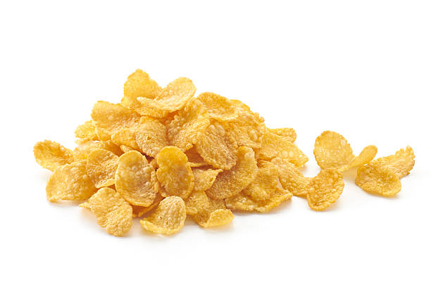 pila de corn flakes (copos de maíz) - corn flakes fotografías e imágenes de stock