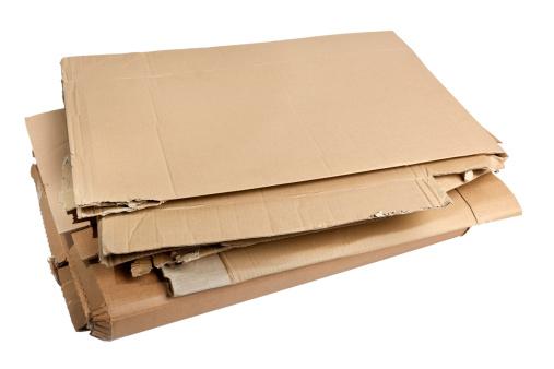 Pile of corrugated cardboard isolated on white background