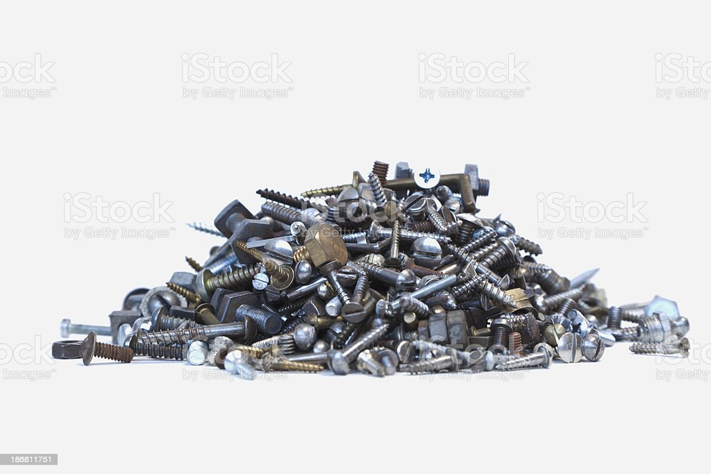 Pile of crews and nuts on white background. royalty-free stock photo
