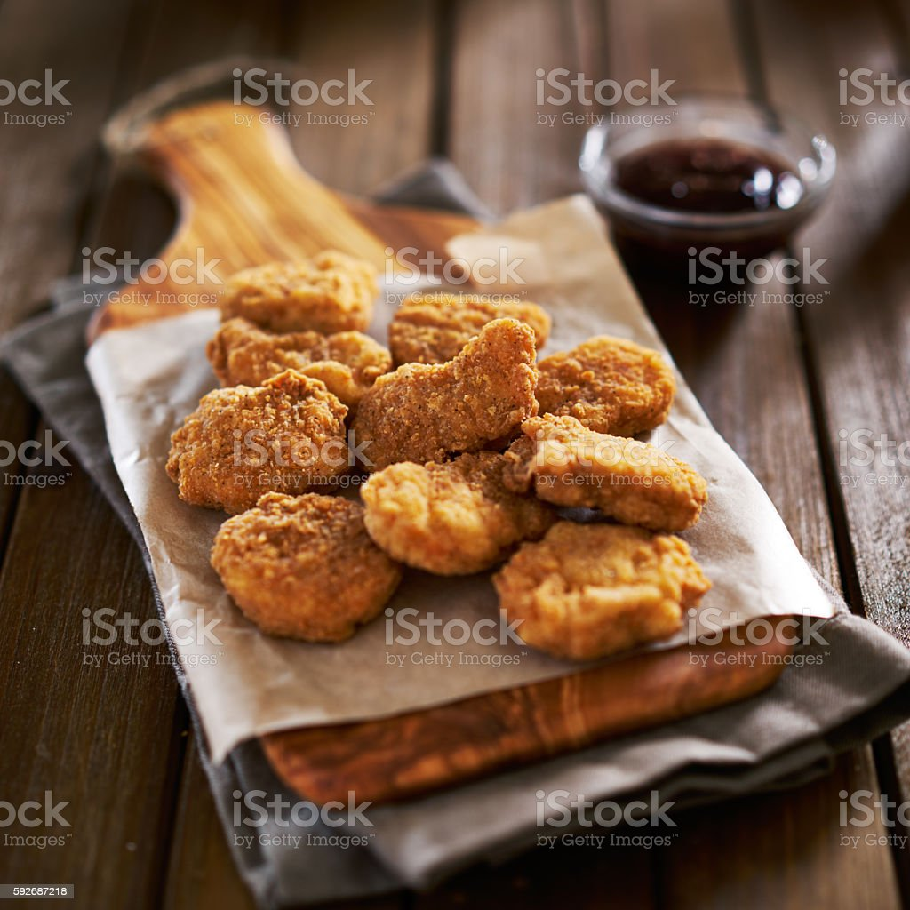 pile of crispy homemade baked chicken nuggets stock photo
