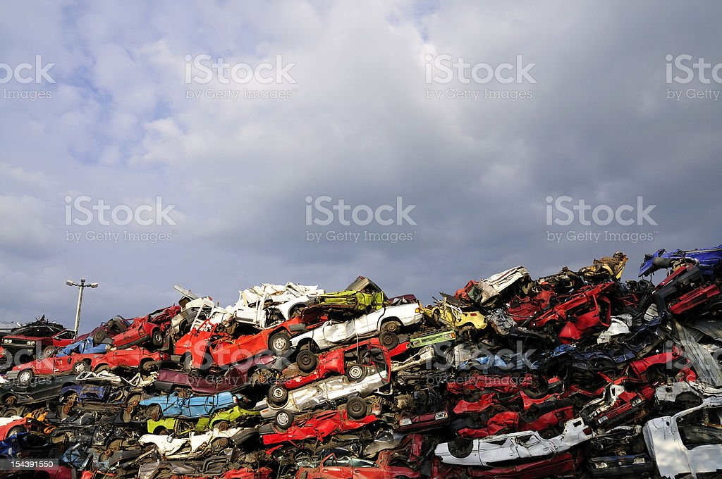 Pile of crushed cars stock photo
