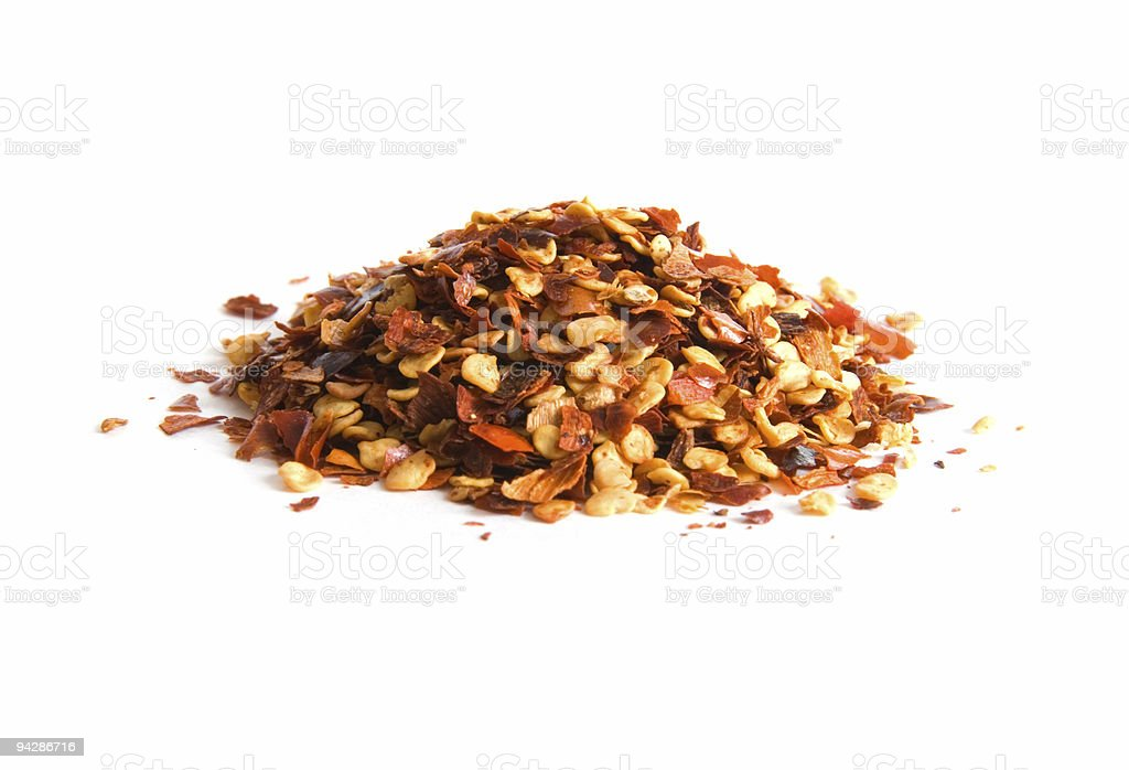 Pile of crushed red pepper on white stock photo