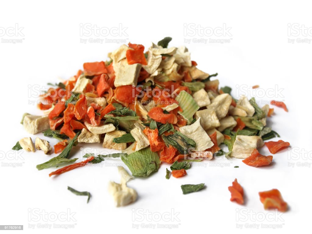 Pile of cut dried vegetables on a white background royalty-free stock photo