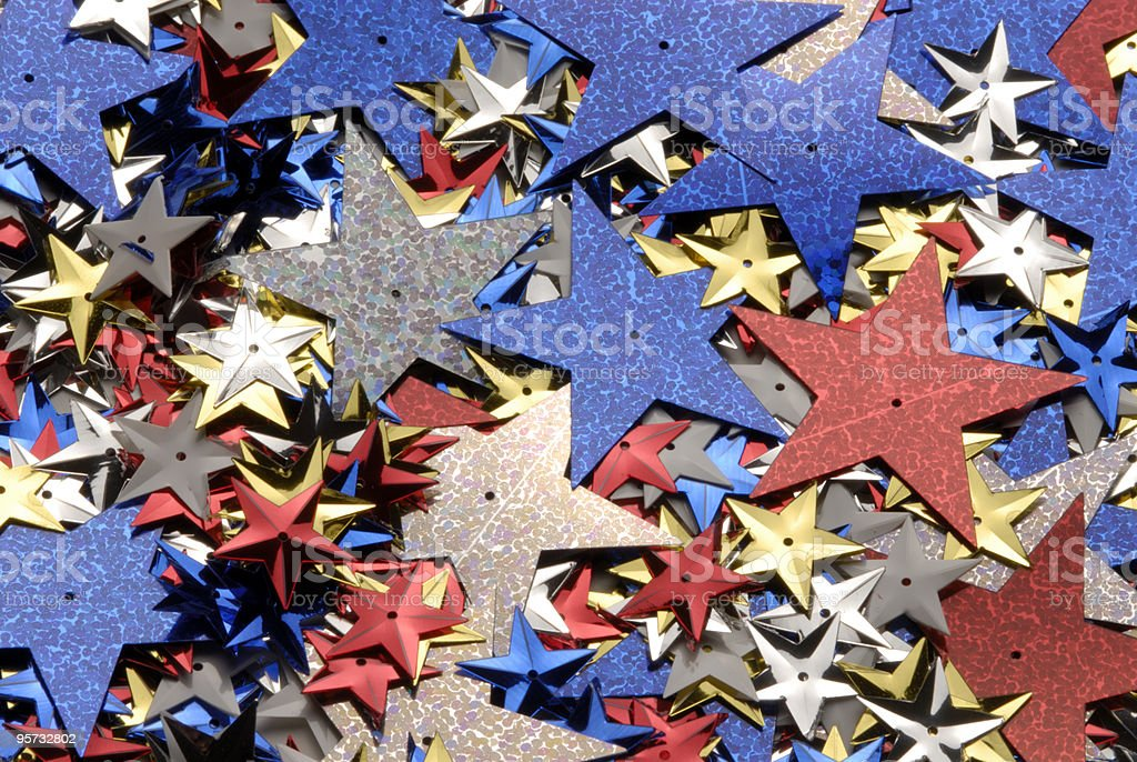 A pile of cut out sparkly paper stars stock photo