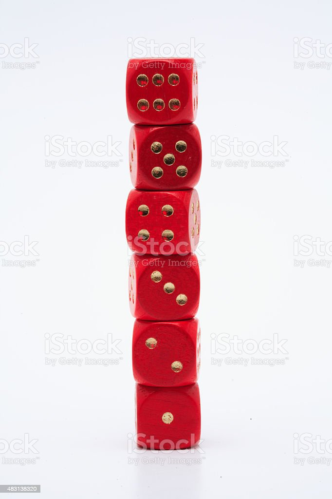 pile of dice showing one to six eyes stock photo