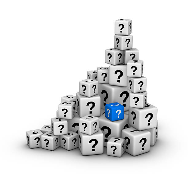 pile of dices with question marks stock photo