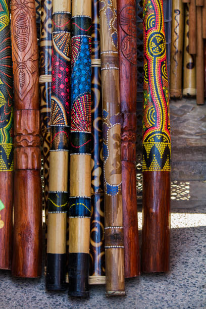 pile of didgeridoo musical instruments - didgeridoo stock photos and pictures