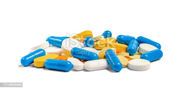 A pile of different multicolored pills, tablets and capsules isolated on white background. Pharmacy theme.