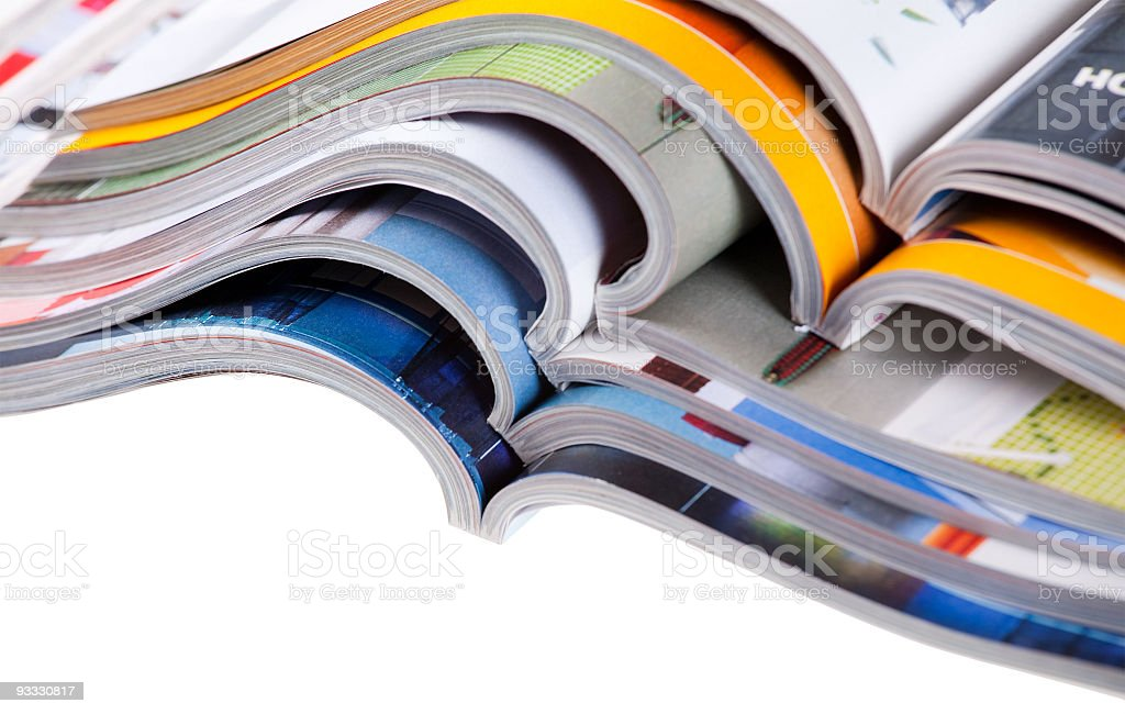 Pile of different types of magazine in white background Pile of colour illustrated magazines on white background. Isolated. Color Image Stock Photo