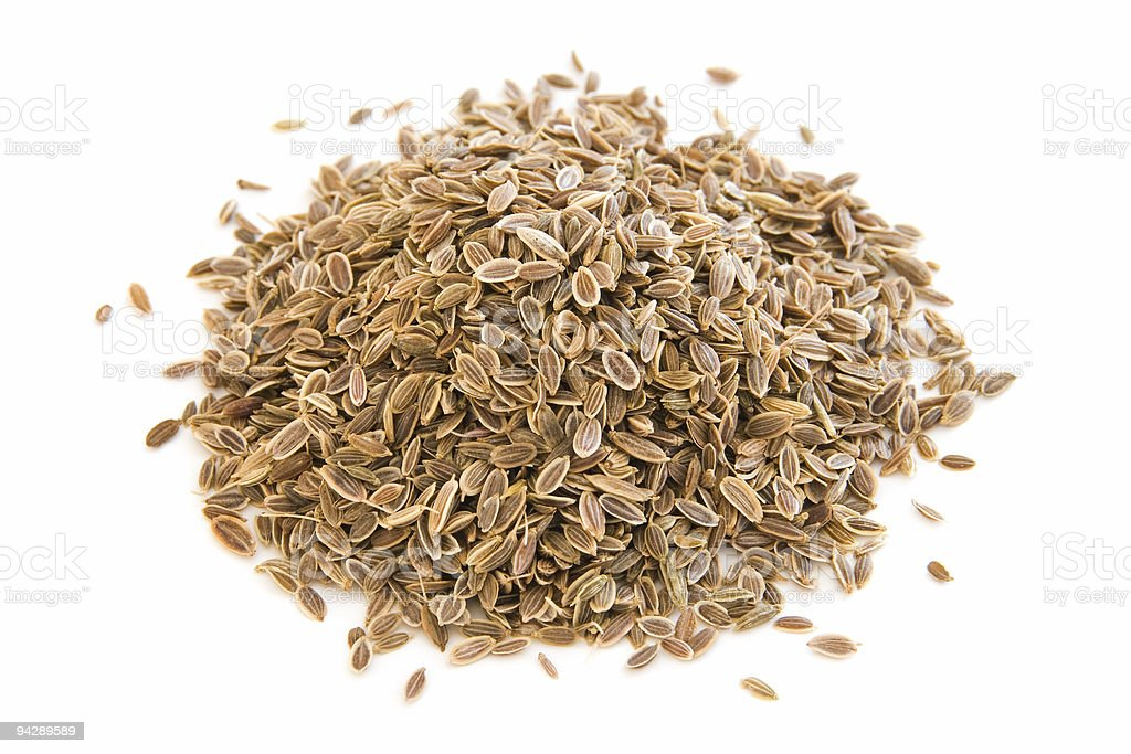 Pile of dill seeds on white stock photo