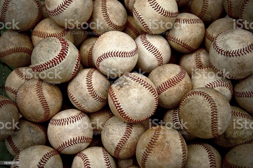 Pile of dirty and antique baseballs stock photo