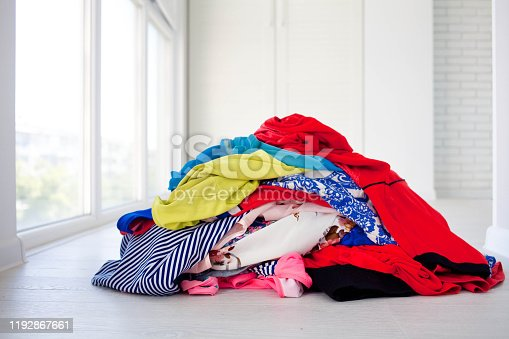 460589747 istock photo Pile of dirty clothes on floor . Clouse up 1192867661