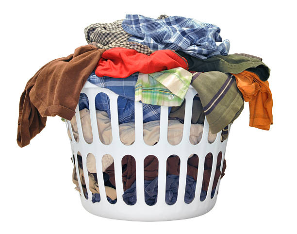 Pile of dirty laundry in a washing basket stock photo