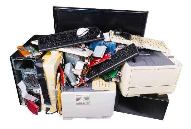 Pile of discarded computer parts isolated on a white background. Old e-waste detail. Eco stock photo
