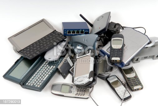 a pile of electronic gadgets that are obsolete