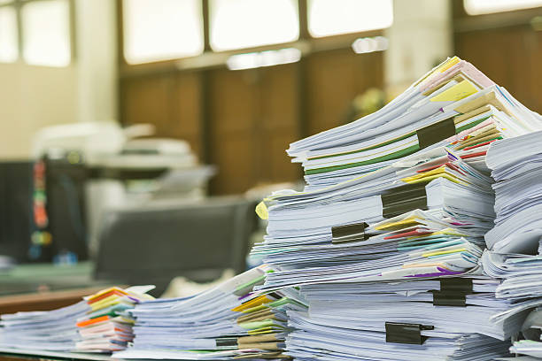 Pile of documents on desk at workplace Pile of documents on desk at workplace bureaucracy stock pictures, royalty-free photos & images
