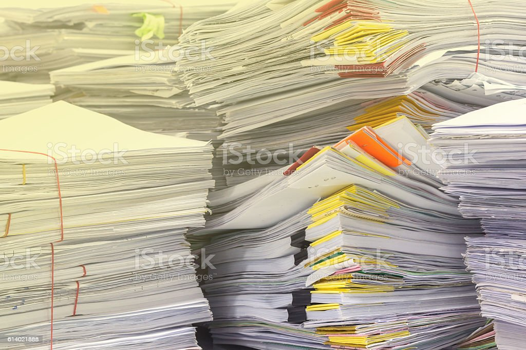 Pile of documents on desk stack stock photo