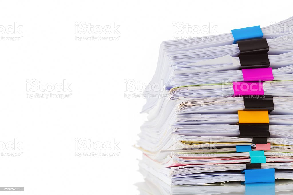 Pile of documents with colorful clips on white background stock photo