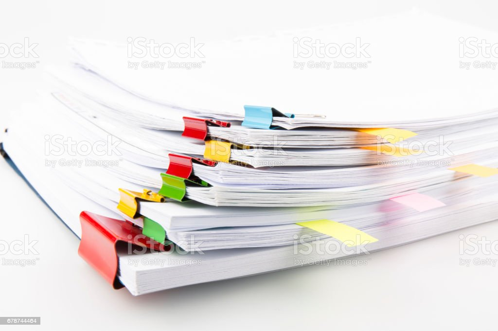 Pile of documents with colorful clips stock photo