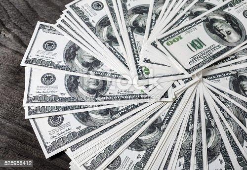 istock Pile of dollars 525958412