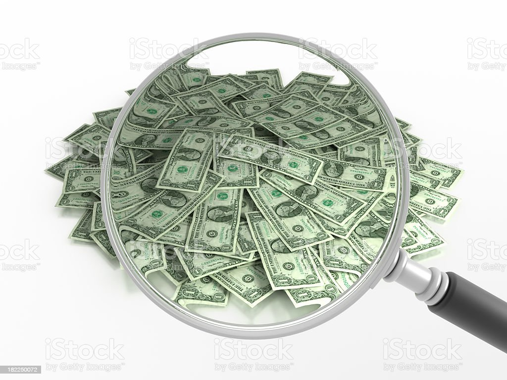 Pile of dollars under the magnifying glass, with clipping path royalty-free stock photo