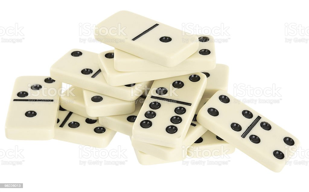 Pile of dominoes isolated on white background royalty-free stock photo