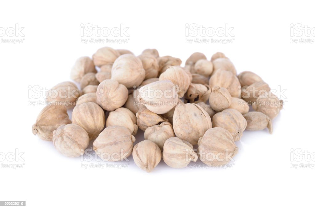 pile of dried cardamom seed on white background stock photo