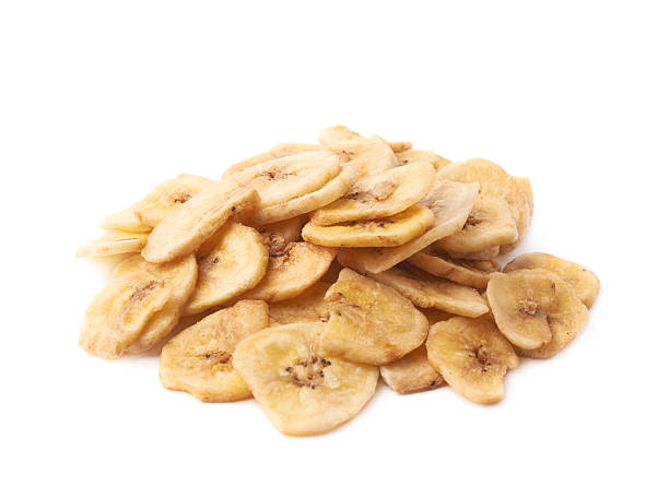 Pile of dried sliced banana snack isolated stock photo