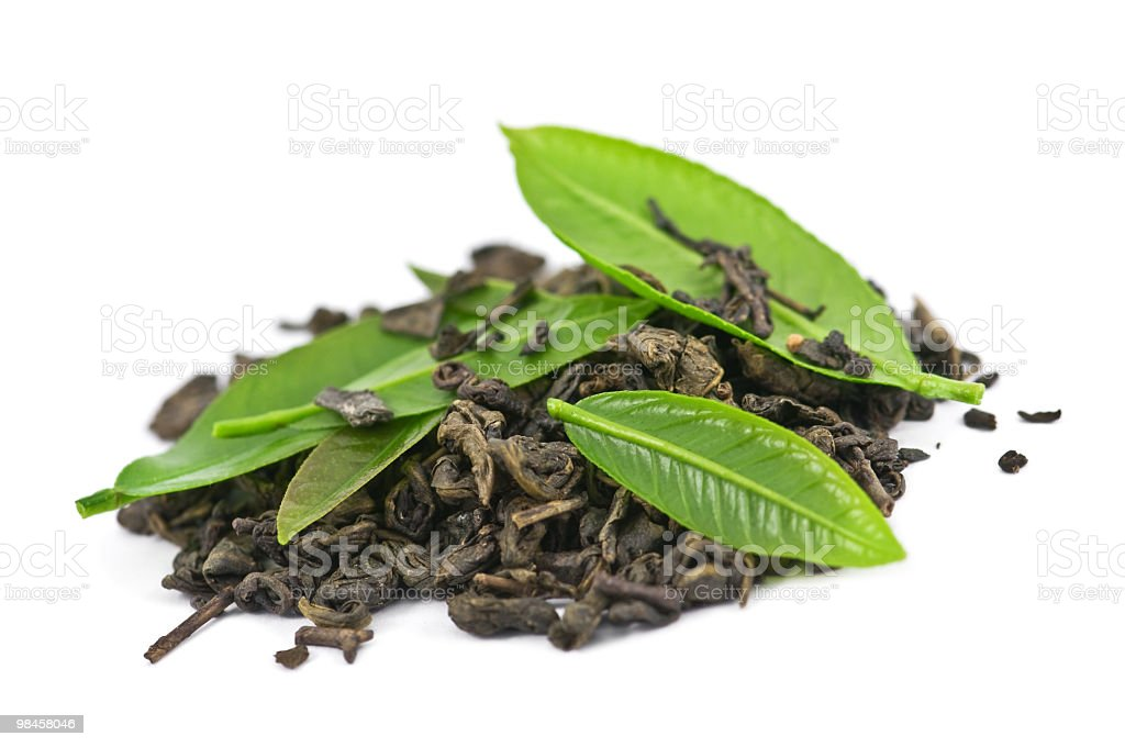A pile of dried tea with fresh green tea leaves on top  royalty-free stock photo