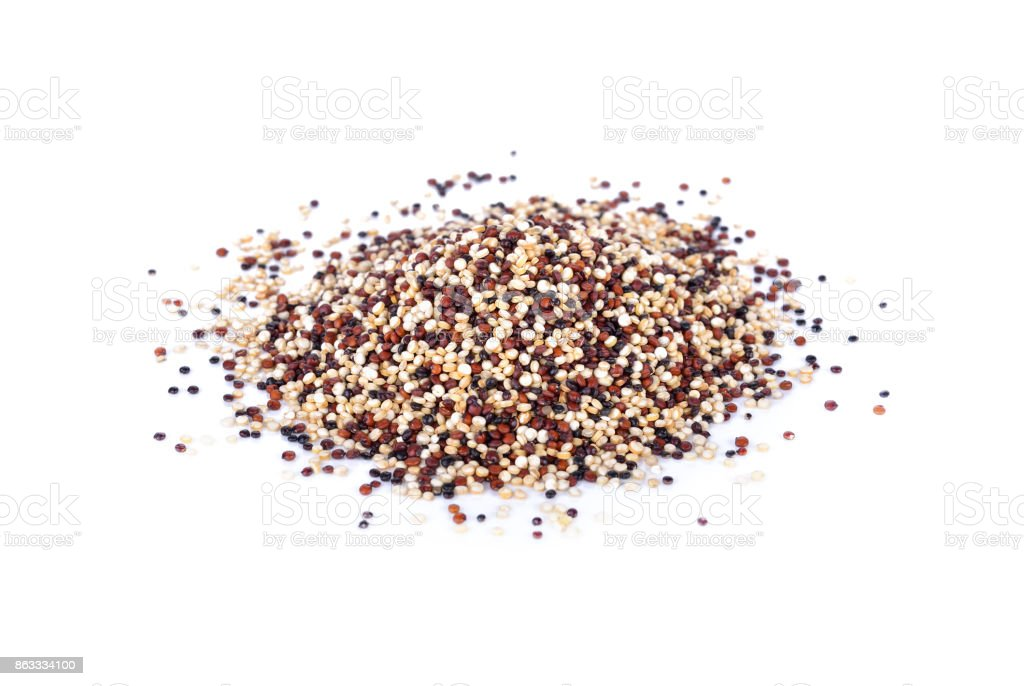 pile of dry tricolor quinoa seeds on white background stock photo