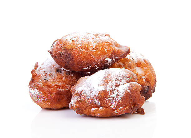 pile of dutch donut also known as oliebollen - oliebollen stockfoto's en -beelden