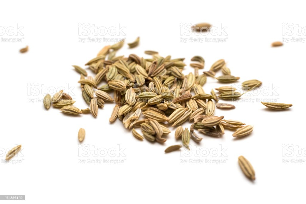 A pile of fennel seeds on a white background stock photo